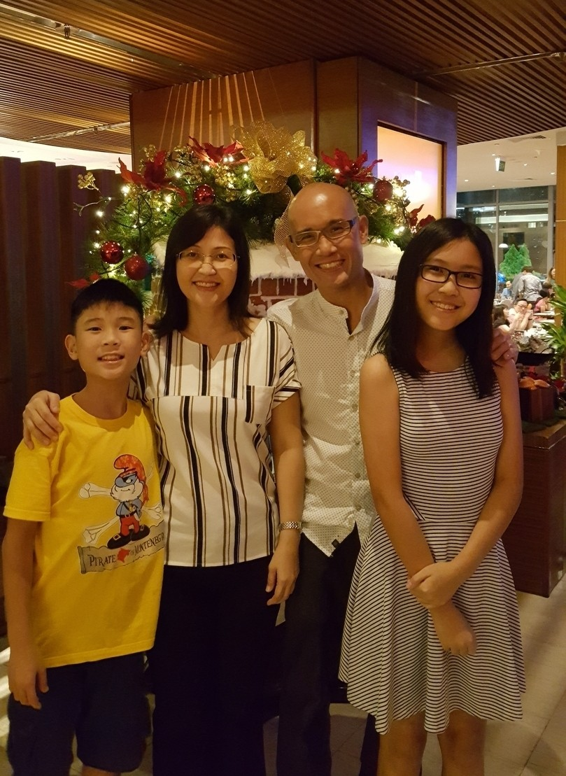 Photo of Rick Wong together with family.