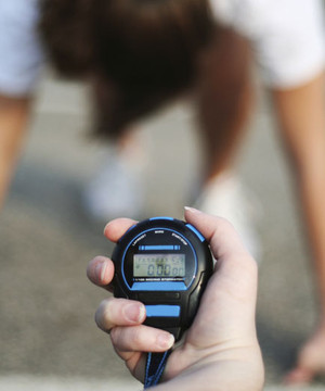 Image of a physical fitness tester starting her stopwatch.