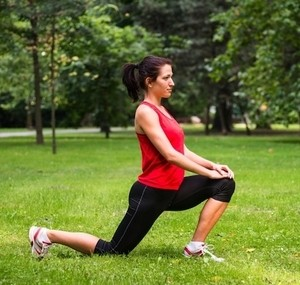 Image of a woman exercising in a park.
