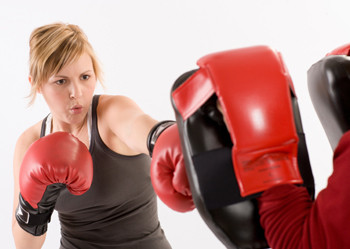 Image of a client doing cardio kickboxing.