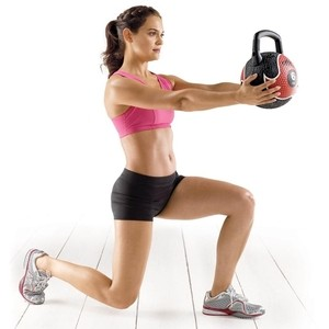 Image of a female fitness client performing a functional fitness workout.