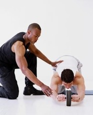Image of a trainer using a portable, gym-free equipment to train his client.