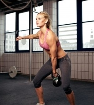 Image of a female client performing a metabolic training routine.