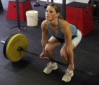 Image of a lady participating in a metabolic training program.