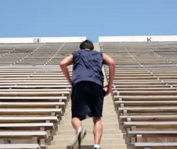 Image of a middle-aged man running up stairs.