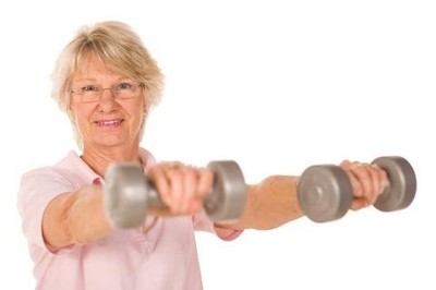 Image of an older lady training with weights.