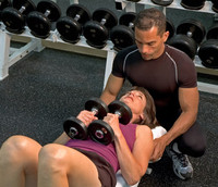 Image of a standard fitness trainer training a client.