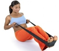 Photo of female working-out with a resistance band.