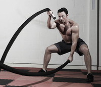 Image of a trainer performing integrated fitness workouts.
