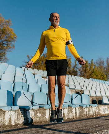 Image of a senior man doing skipping or rope-jumping as a cardio workout.